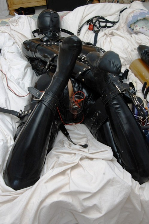 depravpig:  trymeimightlikeit:  andrastephotography:  Heavy Rubber Bondage. from 2004  Mmmmm, I'd love a weekend of this!!!  Hogtie