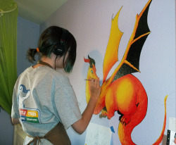 A photo of me painting the mural in this post
