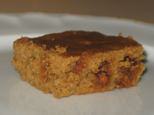 "Pumpkin Chocolate (Cinnamon) Chip Brownies Like all the reviews said, they don't taste quite like brownies, but it's hard to stop eating them once you start. They were really easy to make, despite a few screw-ups along the way. And even though I made what might be my best batch of banana yogurt muffins ever yesterday, I still needed some redemption after the banana lime coconut muffin debacle. I gave all of those muffins away, and deleted the recipe from my Pinterest board. It's dead to me. I poked around my Pinterest board, and when I saw this one I remembered that I had about half a can of pumpkin left that I wanted to use, plus some cinnamon chips waiting in the wings. And it looked good! The reviews strongly stated that the word ""brownie"" was inaccurate, so I didn't have brownie-like expectations, but they all said it was delicious and addictive and worth making again. I agree completely.  I got to use my egg separator, and one of my favorite little glass bowls. It was the usual procedure of wet ingredients and then dry. I started with 1/2 cup of pumpkin, two egg whites, one egg, and a splash or two more than a tablespoon of canola oil.  I put that aside and dove into the dry ingredients. Oh, and I used whole wheat white instead of all purpose flour.  Once I added baking powder, salt, cocoa powder, cinnamon, nutmeg, allspice, and brown sugar I knew I was on to a good thing.  By the way, as I was making this, I had this ridiculous song in my head and I couldn't turn it off. It's from Phineas and Ferb, which we all watch a lot of around here. The song is ""Ducky Momo Is My Friend"" and Candace sings it, and in the video she's a little girl with an oversized head. So yes, while I was stirring or whisking or measuring or pouring, I had ""Ducky Momo Is My Friend"" running through my head. The whole time. Once the dry ingredients were whisked together, I poured them into the first mixture.  I mixed enough to incorporate, then added the cinnamon chips.  I folded them in and then when I went to pour the batter into the pan, I realized that I did not have the right size pan. The recipe said 11 x 7, and mine is probably 9 x 13. D'oh. I spread out the batter and it was mighty thin. I'd gone too far to turn back, though, so I did the best I could to distribute it evenly.  And you know what? It came out of the oven fifteen minutes later looking like this:  And it's delicious! Moist but still crumbly, sweet but not too sweet, flavor-rich and light and addictive. What a great discovery. PUMPKIN CHOCOLATE CHIP BROWNIES RECIPE"