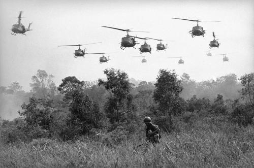 Horst Faas Hovering U.S. Army helicopters pour machine gun fire into tree line to cover the advance of Vietnamese ground troops in an attack on a Viet Cong camp 18 miles north of Tay Ninh on March 29, 1965, which is northwest of Saigon near the Cambodian border. Combined assault routed Viet Cong guerrilla force.