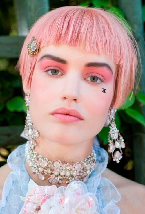 "jaggedbeauty:  Makeup how to: pink & punk at Chanel Cruise 2013. It was Marie Antoinette gone punk when Chanel's Cruise 2012/2013 collection sailed down the runway at the Palace of Versailles. But it wasn't just the clothes that were bold and candy-coloured: angular bobs were supported by a strong make-up look dominated by the colour pink. After the break: an in-depth look at recreating (and adapting) this look for yourself. Skin Creative Director of Chanel makeup, Peter Philips, didn't want to create a ""historic canvas"" on the models' faces, considering other heavy elements of the look. His make-up team used Vitalumiere Moisture-Rich Radiance Fluid Makeup SPF 15 as the base, concealed visible blemishes with Correcteur Perfection Long Lasting Concealer and finished the look with a loose powder, Poudre Universelle Libre Natural Finish on the day of the show. The eyes step-by-step: Pick an eyeshadow that's of a creamy texture, as they're easy to apply on the lid. This Chanel eyeshadow shade is a shimmery mousse, so it applies really easily. Apply an eye primer to the entire lid, so it can hold the strong colour in place. Start with swiping the colour along the top lash line with an eyeshadow brush. Work the product over the lid in a diagonally upward motion into the crease and then take it up to the brow. Blending is the key here, so imagine as though you're painting the top lid of your eye. Use more produce for more intensity and pigmentation. If you want to imitate the exact runway look, brush a little product upwards through the brow. Otherwise stop about 5mm under the brow. Finish up by adding some eyeshadow under the eye – keep it concentrated under the iris. You can also apply a white eye pencil to the waterline, to make the eyes appear more alive. Use an eyelash curler to simply define the lashes and curl them, but don't use any product on them. It's all about the lids here. Cheeks For Chanel Cruise 2013, the make-up look is all about the eyes and the cheeks, as they narrate the entire beauty story for the collection. Using the Joues Contraste Powder Blush in Rose Pétale shade, Philips adds definition to the cheeks for this look. You don't need a bronzer or highlighter for this, as you can use a powder blush to create an illusion of architectural cheekbones. However, if you're using a cream blush, remember to blend it in really well, and all the way till the hairline; you don't want any blotches."