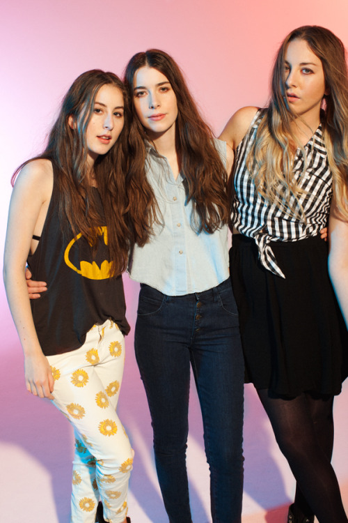 "The Sisters Of Haim Love Them Some Fanny Packs By Us, Photographed by Clarke Tolton  Name: Este, Danielle, and Alana of HaimTen-Second Bio: When they were younger, Este, Danielle, and Alana Haim played in their parents' band, Rockinhaim, around their San Fernando Valley home. They've since grown up, recruited a drummer from outside the family, and founded Haim, a hard-charging indie band marked by the sisters' distinctive three-part harmonies.Favorite '80s memory: ""When we got a Skip-It!"" Favorite GUESS memory: ""Seeing Claudia Schiffer on a billboard in the Sunset Plaza.""Favorite returning '80s fashion trend: ""Fanny packs.""  Eva Vintage Floral Jean White $138, available at Guess; Claudia Jean, $138, available at Guess; Marilyn Top, $59, available at Guess. View the photo and read the article at Refinery29 and The Guess Generation: Celebrating 30 Years of Style"