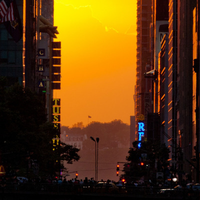 ivanfilios:  365 Project — 152 - Manhattanhenge (set) by Atomox on Flickr.Via Flickr: Despite our beliefs, people stood atop the Park Ave Overpass, traditionally a place pedestrians are not allowed. We saw lots of people breaking the law to get a shot of the bi-yearly Manhattanhenge event.