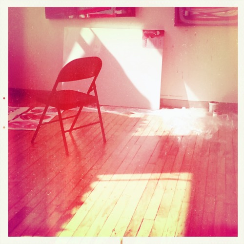 Blank canvas, sunlight and chair.