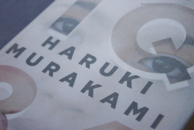 "isserleylovesbooks:  Haruki Murakami's 1Q84: dreaming away slowly.  The novel has two seperate protagonists whom we follow in turn. Aomame is a young physical instructor who, after a bewildering episode involving a taxi and a guardrail, realizes she has entered a parallel world. She calls it '1Q84'.  Meanwhile, her old classmate Tengo, now a maths teacher, rewrites a powerful but raw story that was submitted to a literary contest by an emotionally blunted seventeen-year-old. The edited story, Air Chrysalis, becomes an instant best-seller. Tengo now draws unwanted attention.  Recently I received an Ask asking what I liked about 1Q84 (since I mentioned it in a book challenge post on my personal blog). The lovely person posting personally wasn't a fan, because of the slow-pacedness of the story. So here is my answer, in review form! Biases before reading For one thing, I had been looking forward to this for a LONG time. The wait was made more excruciating by the fact that a Dutch translation had been available for quite some time before we even made our pre-order. Really, publishing gods? A Dutch translation before the English one? SHAME. I'm a devout Murakami fan, so there's bias number two. So as I read I must say I wasn't as wowed as I was by, for example, Hard-boiled Wonderland and the End of the World. The chapter-by-chapter alternation between two completely different worlds and narrators is more instantly fascinating. And yes, the story takes some burrowing into. However, I still really enjoyed reading 1Q84, and I believe it does have that Murakami magic. The characters, for example, were complex and interesting, as I have grown to expect from the author. As protagonists we have lonely Aomame and discontent Tengo, who are connected by a childhood experience neither believes the other would have thought significant. Aomame is so honest and uncompromising, Tengo so caring in a searching way. I love it when characters aren't bent on being liked, and Aomame certainly was a lovely brand of loner.  I enjoyed the unworldly Fuka-Eri and the glimpses of her story, as we can read it Tengo's description of her story, Air Chrysalis. It was interesting trying to figure out who and what she was, exactly. No spoilers, though! As for the plot, it doesn't race, but I enjoyed the creeping parts [a ton of spying on apartments] just as much. The stagnant parts were slow because the corresponding timelines were stagnant for the characters, as well. I have no issue with that, but it does require a certain commitment on the part of the reader not to give up.  Typical Murakami loveliness As a prototype of the lovely language, there is this quote, the full context of which is:  Tengo saw admiration in the eyes of several of his female students, and he realized that he was seducing these seventeen- or eighteen-year-olds through mathematics. His eloquence was a kind of intellectual foreplay. Mathematical functions stroked their backs, theorems sent warm breath into their ears.  In addition to wonderful feats of lingual genius, there are the typical Murakami creations, both subplot-wise as the general context. The world of 1Q84 is the exact mix of impossible and realistic that it continues to fascinate. I adore the way Murakami's brand of magical realism (like Márquez') is so subtle - it gets you hooked in a way the obvious doesn't. As usual, 1Q84 contains a number of interesting side-stories or in-story anekdotes, such as the backstory of the older woman Aomame is hired by. One of my favorite characters in the book is Ushikawa, a detective hired to investigate Tengo after he rewrote Air Chrysalis. He's not immediately likeable, but as I said before, I kind of like that. Interestingly, we first meet him through the distrusting eyes of Tengo, who feels hunted and naturally rather dislikes him, but after a while Ushikawa becomes a point-of-view character and overall, rather fascinates. He has one of those storylines that make you say ""well, that could not have gone any other way"". I like tragic inevitability now. Tragic inevitability is cool. As a relatively minor character, bodyguard Tamaru is quite interesting. The bond he develops with Aomame is fascinating because it's founded on mutual professional respect, but evolves into a personal caring. And no, there's no romance involved. And yet! One thing that got on my nerves was (what I perceived as) the overly detailed clothing descriptions. Often, they seemed repetitive and unnecessary and honestly, who even cares what brand his jacket was?  However, as pet peeves go, that's a pretty small one for such a long story. And who knows: maybe some fashion enthousiasts out there are now very grateful for Murakami's detail. As to the pace: Yes, it was slow. Yes, it could have been more terse and condensed. Should it have been? Personally, I very much enjoyed it the way it is. That said, it's the kind of book that you should schedule large chunks of time for, because once you're in, you're in. I'm absolutely re-reading it whenever I'm home sick for a few days. Because of its size (and prettiness) it's less useful as a ""take with me"" book.  Overall: Definitely enjoyable, recognisably Murakami and a plot that, while slow, does draw you in entirely. For: Fans of magical realism who have some time on their hands and don't mind staking out in an alternate universe for some time."