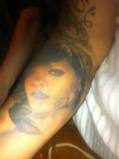 explore-your-talents:  someone really got Rihanna's face tatted on them.. it looks nice but… omg.