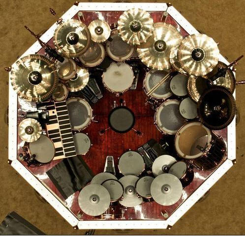 zmaskm:  thegearporn:  Neil Peart's drum kit. If you thought you had enough toms, cymbals, etc. you were wrong.  I'd be willing to bet all of Neil's drums cost more than a given person's house and cars combined…