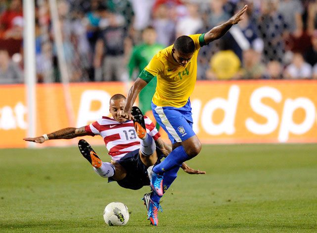 United States' Jermaine Jones (13) falls to the ground against Brazil's Juan (14) during the second half of an international friendly soccer game on Wednesday. Brazil won 4-1. (AP Photo/Nick Wass) WAHL: U.S had its share of good moments in loss to Brazil