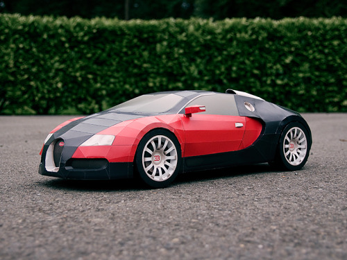 Your Own Hand Built Bugatti Veyron, Free That's right, all 159 parts are free but you do have to assemble it yourself. It only takes a few days to build one with only a few tools that you probably have laying around the house. This is for anyone with the time, know-how, and patience. What's the catch? It's approximately 1:6 scale, oh yes, and it's made of paper. You can download all 44 printable pages from VisualSpicer for free. They ask for donations for those who download, but it's optional. Prints come with full instructions so assembly shouldn't be that difficult, just time consuming. There are some pretty impressive builds on the site too. Check out one of the time lapsed build videos which is pretty cool here.
