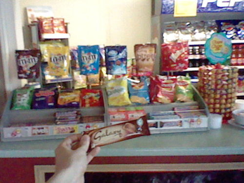 Top half of photo: How I arrange the confectionary stand in the box office at the cinema I work at.  The stands were provided by Mars.  While most people wouldn't give a crap, I deliberately put all the Mars products on the hangy things, while putting the non-mars ones down below.  Half out of respect for the branding on the stand, half because it annoyed me too much to have the Cadbury/Nestlé/Skittles bags hanging with the Mars ones since they're all different shapes. Bottom half of photo: What was left for me specifically after I left work last night by the Mars representative who popped in to make some queries about our sales, just because they approved of the display so much.  For once my casual OCD has been appreciated.  8D
