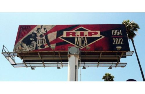 """Shepard Fairey and Glen E. Friedman collaborated on a billboard in reverence to the late Adam ""MCA"" Yauch, located on Hollywood & Highland in Los Angeles. Fairey based the billboard on a photo Friedman took of the Beastie Boys, and included the years of MCA's life, 1964-2012."""