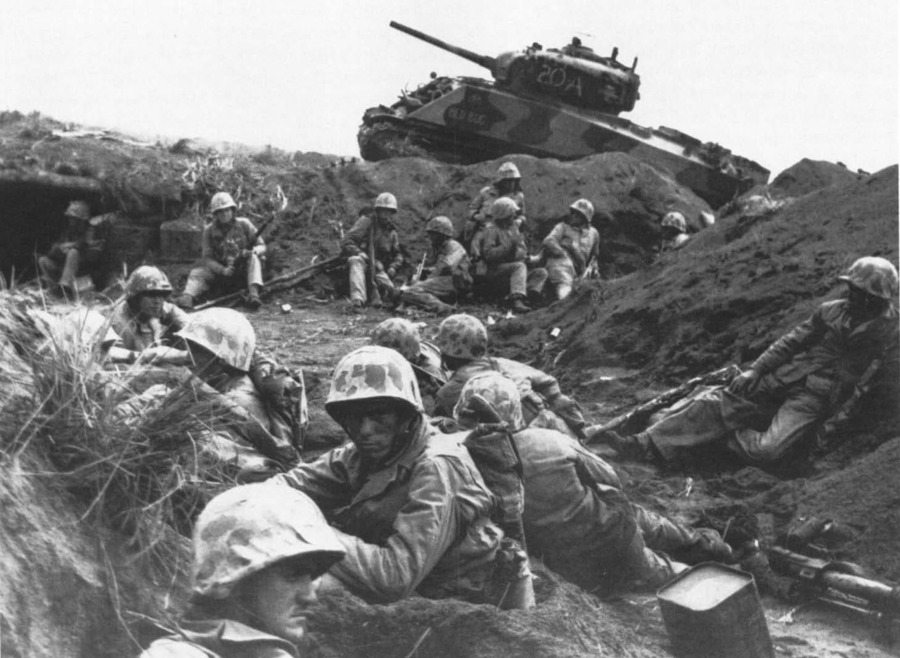 tennozan:  Weary troops of Company G, 2d Battalion, 24th Marines,rest in a ditch, guarded by