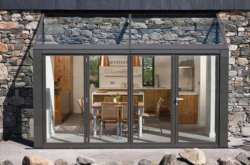 freshome:  Two Stone Cottages Fused With A Glass Stairwell Enclosure
