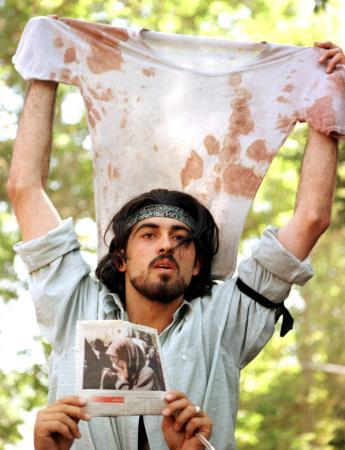 An Iranian Protester showing the bloody shirt of a fellow Protester. Student Protest of July 1999, Tehran, Iran.