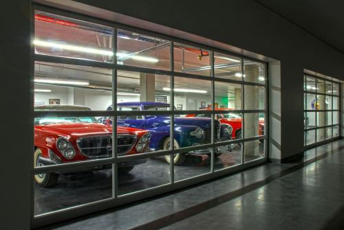 "America's Largest Car Museum Opens Tomorrow If you're from the Seattle/Tacoma area, then you're more fortunate than the rest of us, because opening tomorrow, June 2, is LeMay Museum, ""America's Car Museum,"" located right next to the Tacoma Dome. The building is shown in the first image above. It's basically a beautifully crafted, four-story warehouse, holding some of the best classic and vintage cars the U.S. has ever seen. The museum was created by family and friends of Harold LeMay, the man with the largest car collection in the world. Every car inside the place was his and after he died, they wanted to honor him and celebrate America's love affair with the automobile by sharing his collection with others and thank the car gods they did because the collection is extensive. Take a walk through the building and you'll find well known classics like several Model T's, some great late-50s MOPARs, and of course some late-60s/early-70s muscle cars. But look a bit deeper and you'll find some seriously rare cars from America's past including a single cylinder 1906 Cadillac Model M, a 1926 Oldsmobile Holden 30D, a beautiful 1928 Chrysler Series 72, a 1930 Duesenberg Model J, and a 1948 Tucker! In addition, there are cars from the many companies that weren't around for too long in the beginning of the 20th century and some European cars like a Delorean, a 1965 Lotus 35, a Citroen 2CV, and a Bristol Bus. Starting tomorrow, it will be the largest car museum in the U.S. They will be having a grand opening all this weekend and for $14, you get a slice of motoring heaven. Photos via LeMay's Facebook page and information via LeMay's website."