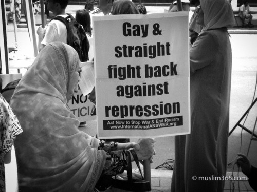 Gay & Straight Fight Back Against Repression Washington, DC – A muslim woman holds up a sign at an anti-war rally. (Javed Memon)