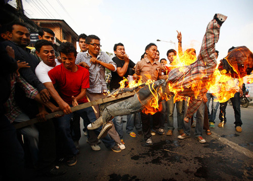Kathmandu, Nepal: Nepalese students burn an effigy of Prime Minister Baburam Bhattarai. Photograph: Navesh Chitrakar/Reuters 24 hours in Pictures 31 May 2012