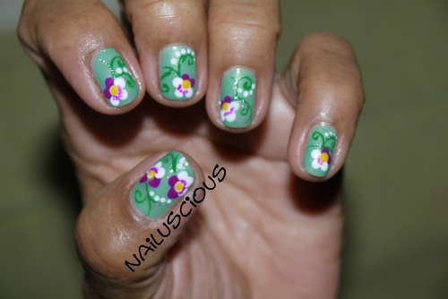 I did these on my mom today. She really likes flowers so I had to do the pansies on her.