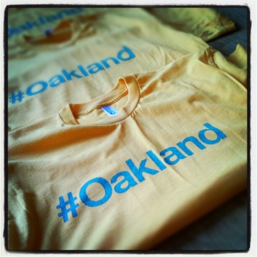 overunity26:  Green & Gold ones! #oakland T's by #homeygrown (Taken with instagram)  let's go oakland! click the photo to visit ye'olde online shoppe and grab one of your very own.