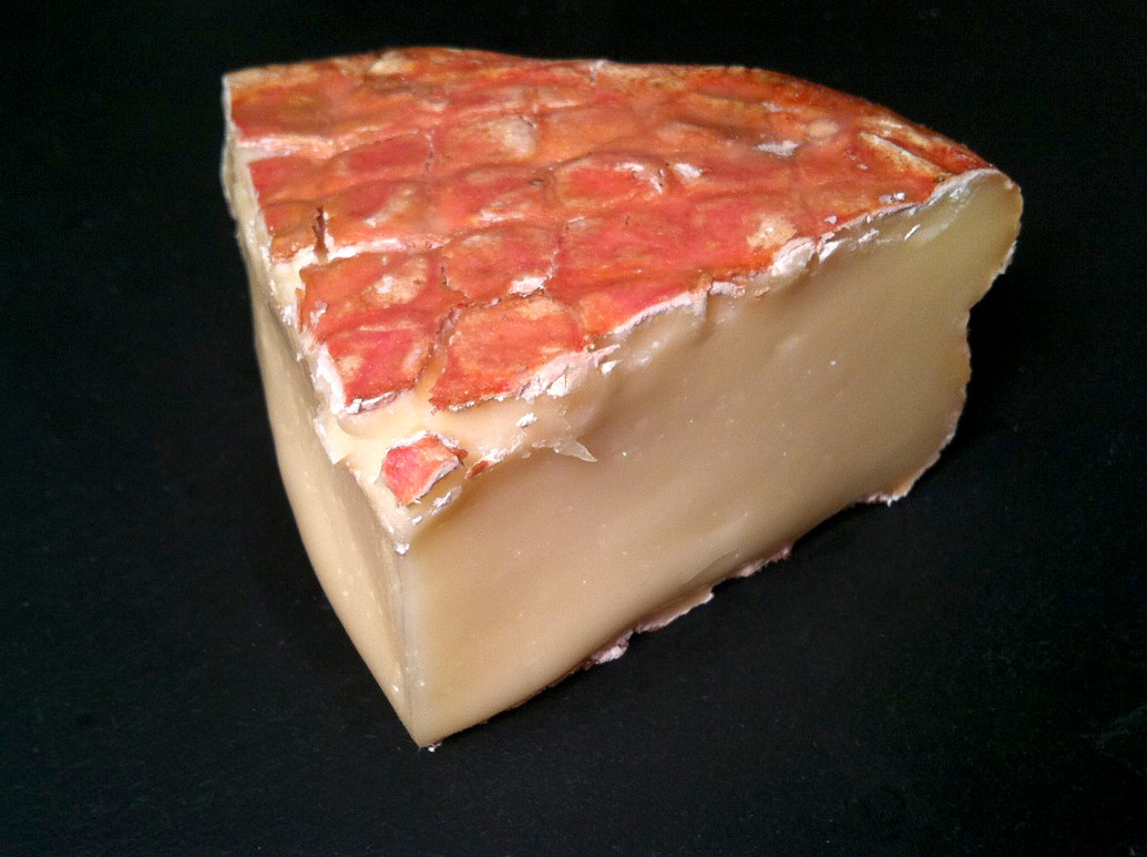 cheesenotes:  Paesanella, from the Ciresa Family, is produced in the Val Taleggio, an Alpine valley of Lombardy, Italy — best known for its namesake cheese, of course, but also home to many other fine cheeses. The Paesanella, also a washed rind, is milder than its better-known cousin. The rind is pink and sticky, with a bit of sandy grit to it (a quality often seen in washed rinds, it comes from the deposit of minerals after repeated washes with a salty brine). The paste is soft and bulging, with a creamy texture and a mild barny pungency. In flavor it is sweet, meaty and full with mushroom and hay notes. Purchased at Murray's.