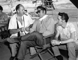Elvis, Colonel Parker and Gene Smith relax between takes of Elvis's 1956 film, Love Me Tender.