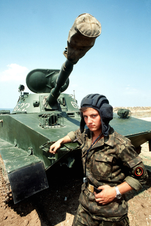 fuldagap:  Soviet naval infantryman stands with a PT-76 light amphibious tank during the second goodwill visit of American warships to a Soviet port, 1989.