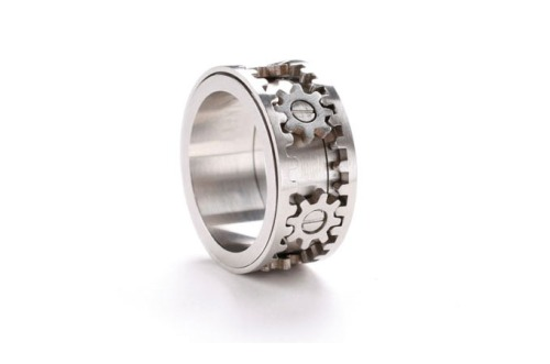 Gear Ring is a stainless steel ring with micro-precision gears that turn in unison when the outer rims are spun….