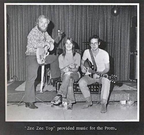 ": ZZ Top - ""Prom Photo"". . This picture shows a very young Billy Gibbons, Dusty Hill, and Frank Beard in a photo for a Texas prom roundabout 1970 or 1971. Allegedly, the unbearded Billy is holding his ""Pearly Gates"" 1959 Les Paul (Gibson's replicas of Pearly Gates sold for $25k). This is the earliest known picture of the band in its current lineup, and one of the last of Reverend Billy without a beard and sunglasses."