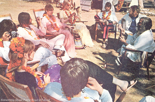 In The Shade February 1968 - The Beatles party relaxing in the shade with Maharishi while waiting for the photographer to finish setting up for the group portrait of all the students at the Rishikesh ashram. (Clockwise from bottom) Paul, Pattie, George, John, Cynthia, Maureen, Ringo, Mike Love, and Maharishi. Photo from Saturday Evening Post magazine, May 4, 1968 issue. Scan from the Something About Pattie Boyd group at Yahoo!