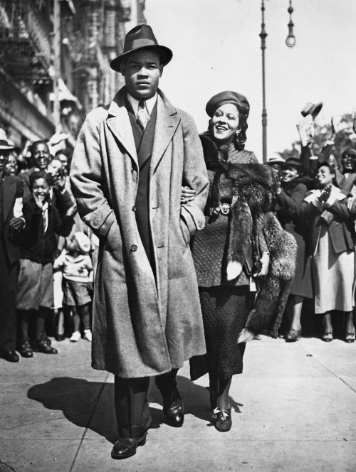 theredhairing:  Mr. and Mrs. Joe Louis take a stroll though Harlem, September 25, 1935.
