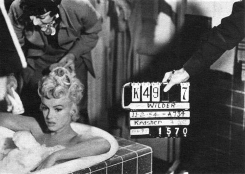 Marilyn filming a scene from The Seven Year Itch (1955) directed by Billy Wilder.