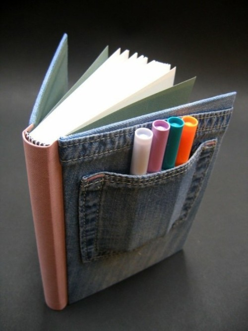 "Pocket Journal by Andrea Kohler ""This small hardbound journal is covered in cloth sourced from children's clothing. In the pocket on the cover are 4 markers, ideal for keeping your children happy while waiting for dinner at the restaurant. The 80(160 both sides)pages of 5""x 6 1/2"" white paper are hand sewn and suitable for both drawing or writing. Thanks to its convenient size it will fit in your purse."""