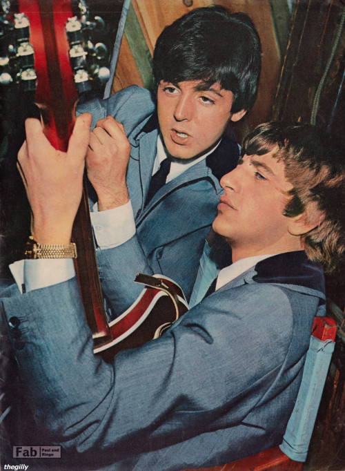 thegilly:  Looming not so large in his legend. Paul teaches Ringo to play the guitar backstage at the Scala theatre during the filming of A Hard Day's Night, 2 April 1964.