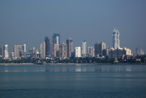urbanterritory:  Mumbai मुम्बई Skyline.With 14 million people in the urban district and more than 21 million for the whole metropolitan area, Mumbai मुम्बई is the most populated of India.The population density is estimated to be about 22,000 persons per square kilometer.As of 2009, Mumbai was named an Alpha world city Mumbai is also the richest city in India and has the highest GDP of any city in South, West or Central Asia. by vassilis_cy on Flickr.