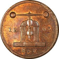 a coin with an impression of a coining press (via THE GOLDEN SMITH: A Pressing Matter)