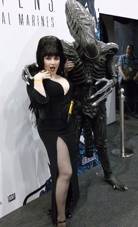 Character: Elvira - Mistress of the Dark with Abe the Xeno. Costumer: littlemissmetamorph Abe was born in his. Photographer: Chris Cooper Event: London Expo May 2012 Submitted by: littlemissmetamorph