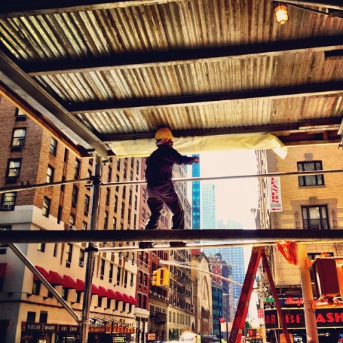 Construction worker on a wire (Taken with Instagram at 888 7th Ave)