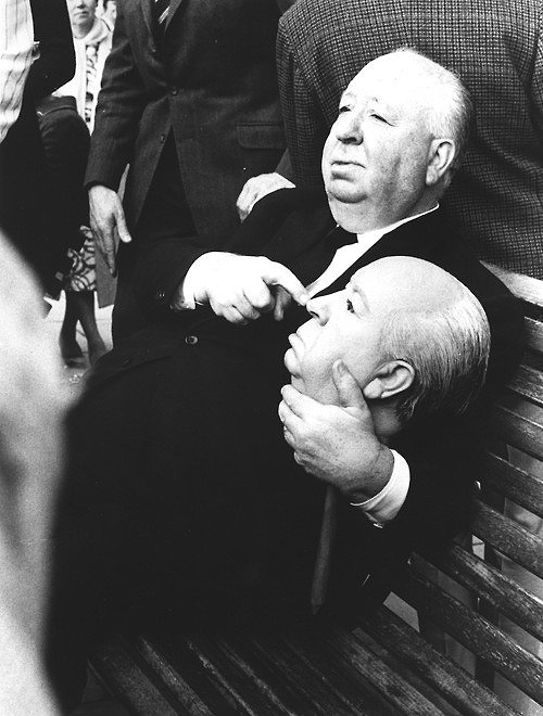 vintagesonia:  Alfred Hitchcock holding a replica dummy head. The dummy head was used in the 1972 film, Frenzy trailer for the body of Hitchcock floating down the River Thames.