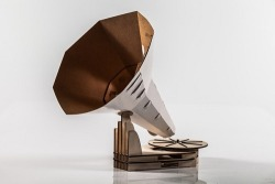 The DIY Gramophone Made Out Of Paper. Design student, Jón Hólmgeirsson, from the Iceland Academy of the Arts has designed a fold-it-yourself gramaphone. Called the 'Jónófón', the paper gramophone consists of a plywood base, a paper cup, and a thick paper horn to amplify sound. Yet another item to add to my list of nifty things I'd like to have. Too bad he hasn't announced his release date yet.