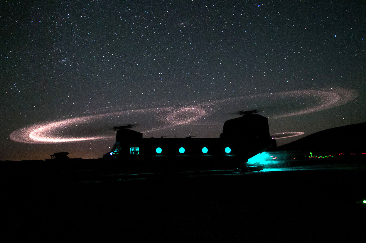 "From Afghanistan: May 2012, one of 42 photos. Dust lights up the rotors of a CH-47 Chinook helicopter as paratroopers with 3rd Squadron, 73rd Cavalry Regiment load for an air assault mission near Combat Outpost Ab Band in Ghazni province, Afghanistan, on May 23, 2012. Small sand particles striking titanium/nickel abrasion strips on the rotors causes a visible corona at night. In 2009, photographer Michael Yon dubbed this phenomenon the ""Kopp-Etchells effect"", to honor Cpl. Benjamin Kopp, and Cpl. Joseph Etchells, recently fallen American and British soldiers. (U.S. Army/Sgt. Mike MacLeod)"