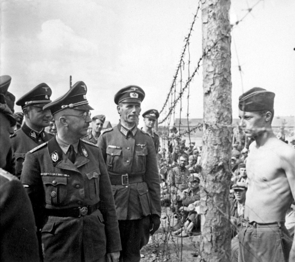 """PoW Horace Greasley defiantly confronts Heinrich Himmler during an inspection of the camp he was confined in. Greasley also famously escaped from the camp and snuck back in more than 200 times to meet in secret with a local German girl he had fallen in love with."""