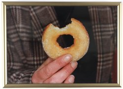 "Happy National Doughnut Day! Did you know that this historic day was created by The Salvation Army to honor the ""Lassies"" who served donuts to soldiers during World War I?  ""Donuts. Is there anything they can't do?"" - Matt Groening   Pictured: Martin Parr, Untitled [donut with bite mark], from the series British Food, 1995"
