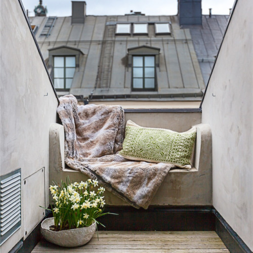 rooftop terrace with a fur throw blanket
