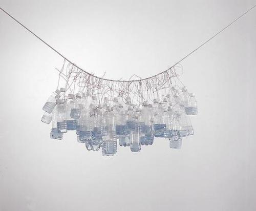 "artlog:  Tony Feher, It Seemed a Beautiful Day, 2002, 48 x 23 x23"", clear plastic beverage bottles with white screw caps, galvanized steel wire"
