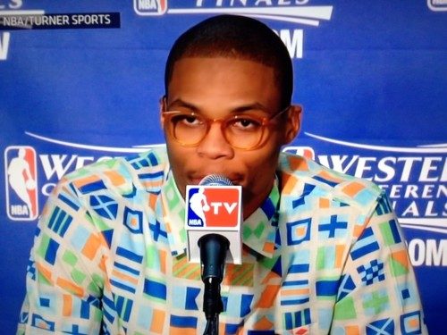 "Here, Russell is sporting a shirt covered in Nautical flags in various neon colors. In the words of Charles Barkley, ""We need to have an intervention."""