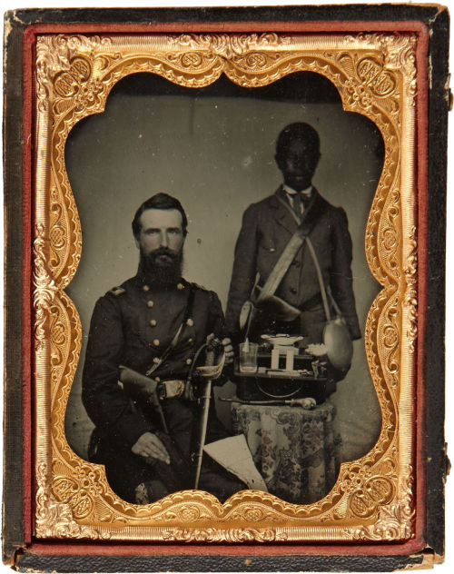 tuesday-johnson:  ca. 1860's, [ambrotype portrait of Union colonel Benjamin Franklin Watson with his servant and a table with an assortment of objects] via Heritage Auctions