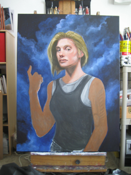 Kara Thrace, second oil sitting.  Refined some edges and values on the face and generally blocked in the background and underlying flesh tones for the rest of the body.