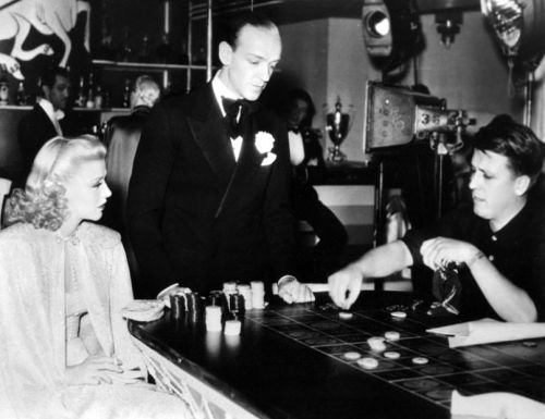oldgoodhollywood:  Ginger Rogers and Fred Astaire pay attention to Swing Time director George Stevens, 1936