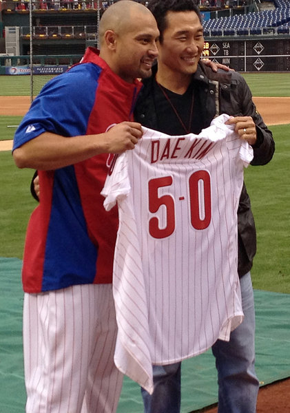 Daniel Dae Kim visits Philadelphia PhilliesChannel APA  Earlier this year, Phillies' pitcher Shane Victorino made an appearance on Hawaii Five-O and made a new friend on the set with Daniel Dae Kim. Hawaii Five-O and Lost star Daniel grew up in the Easton, PA area and has been a lifelong Phillies fans. Shane paid back Daniel's hospitality with his recent visit to a Philadelphia Phillies game. The actor threw out the first pitch before the Phillies vs Mets game. He was even given a special jersey with the number 50, a nod to the TV show.