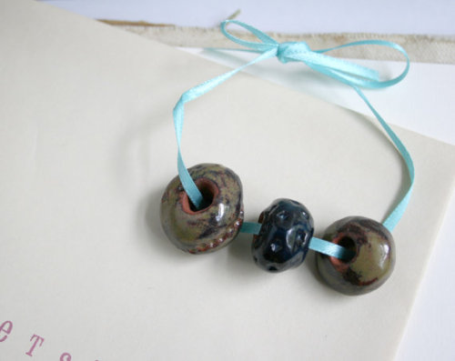 Sikiu (via Terracotta Brown and Black Glazed Beads by Sikiu on Etsy)